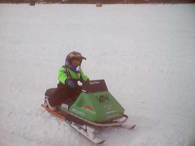 72 green Kitty snowmobile